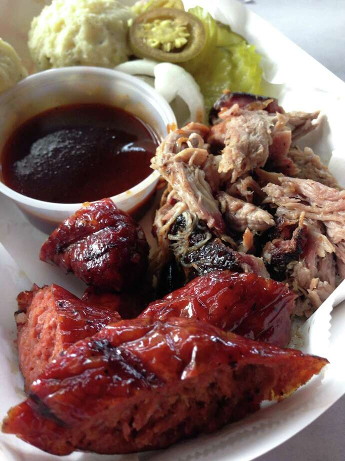 Sausage and pulled pork plate at Gatlin's BBQ during Labor Day preview of the new restaurant at 3510 Ella Blvd. Photo: Greg Morago