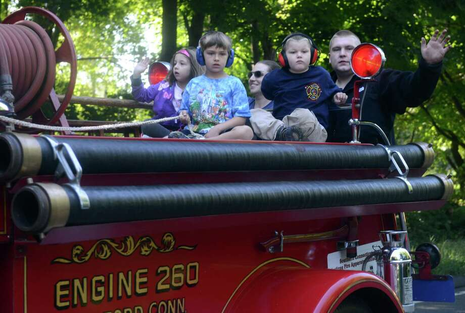 The 42nd Annual Engine 260 Antique Fire Apparatus Show & Muster at Eisenhower Park in Milford, Conn. Saturday, Sept. 7, 2013. Photo: Autumn Driscoll / Autumn Driscoll / Connecticut Post