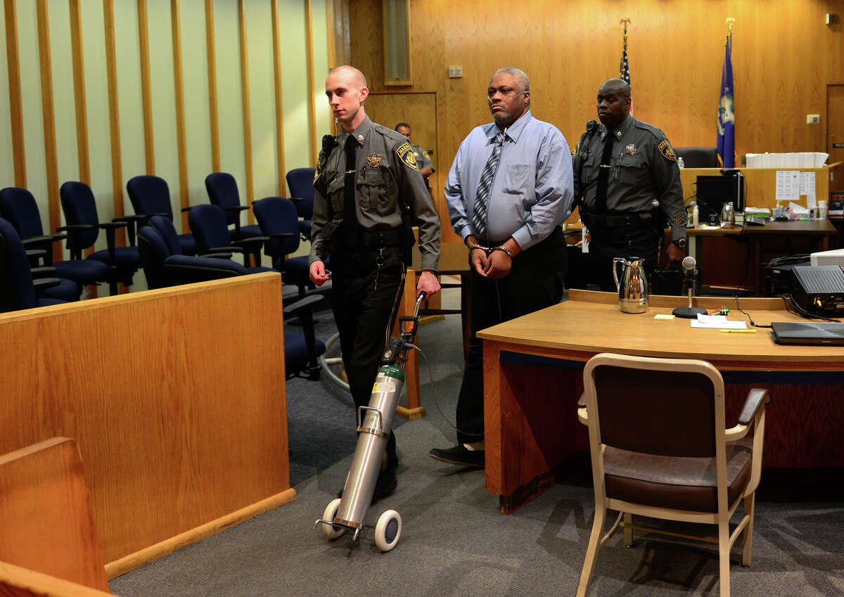 Defendant Leonard Jackson is led out of the courtroom after a jury found him not guilty in his trial for the Bridgeport murder of Estella Brantley at Superior Court in Bridgeport, Conn. in October, 2014. He went back to prison to finish a sentence on unrelated charges.