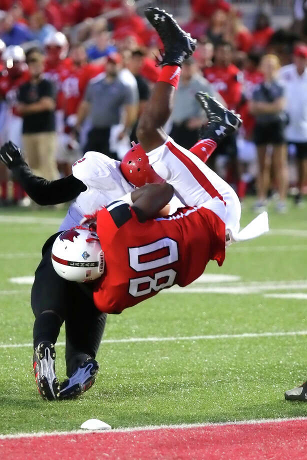 Martell Hawthorne, 80, gets flipped after making the catch at the 1 yardline during the game between the Lamar Cardinals and Bacone College at Provost Umphrey Stadium Saturday night, September 5th, 2015 - photo provided by Kyle Ezell