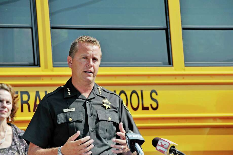 Albany County Sheriff Craig Apple addresses those gathered for a school bus safety press conference at AAA Hudson Valley on Tuesday, Sept. 8, 2015, in Albany, N.Y.  The event was held to stress to drives the rules for stopping for school buses where children are being picked up or dropped off.  (Paul Buckowski / Times Union) Photo: PAUL BUCKOWSKI / 00033261A