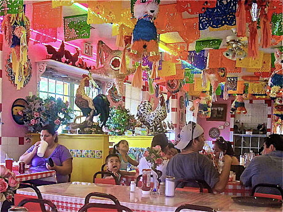 Taqueria Laredo is as colorful inside as outside. Photo: Alison Cook