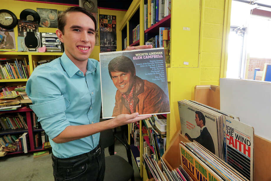 Alejandro Callaghan holds a Glen Campbell album he found while combing through the latest batch of albums for classics he can add to his collection at the Roy Maas Youth Alternative Thrift Shop, 3103 West Avenue,  on Monday, August 31, 2015.  MARVIN PFEIFFER/ mpfeiffer@express-news.net Photo: Marvin Pfeiffer, Staff / San Antonio Express-News / Express-News 2015
