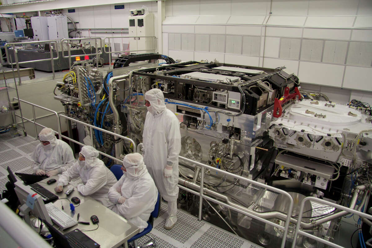 ASML employees working in the Wilton cleanroom.