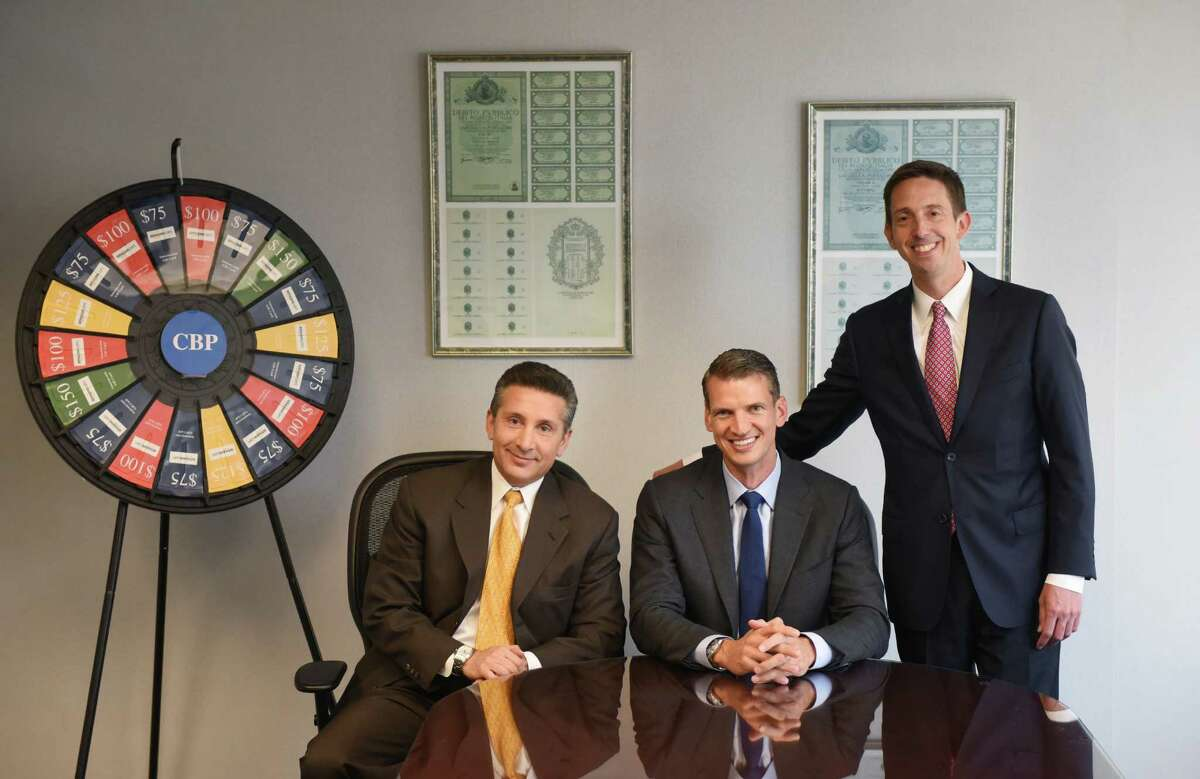 Founder and Principal Gary Piantedosi, left, CEO Chris Peck, center, and Presdient Robert Houghton pose in the conference room at the CBP office in Stamford, Conn. Monday, July 13, 2015. The privately-owned mid-size consulting firm was named one of the area's best workplaces.