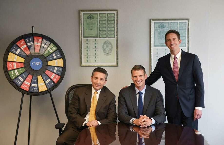Founder and Principal Gary Piantedosi, left, CEO Chris Peck, center, and Presdient Robert Houghton pose in the conference room at the CBP office in Stamford, Conn. Monday, July 13, 2015.  The privately-owned mid-size consulting firm was named one of the area's best workplaces. Photo: Tyler Sizemore / Hearst Connecticut Media / Greenwich Time