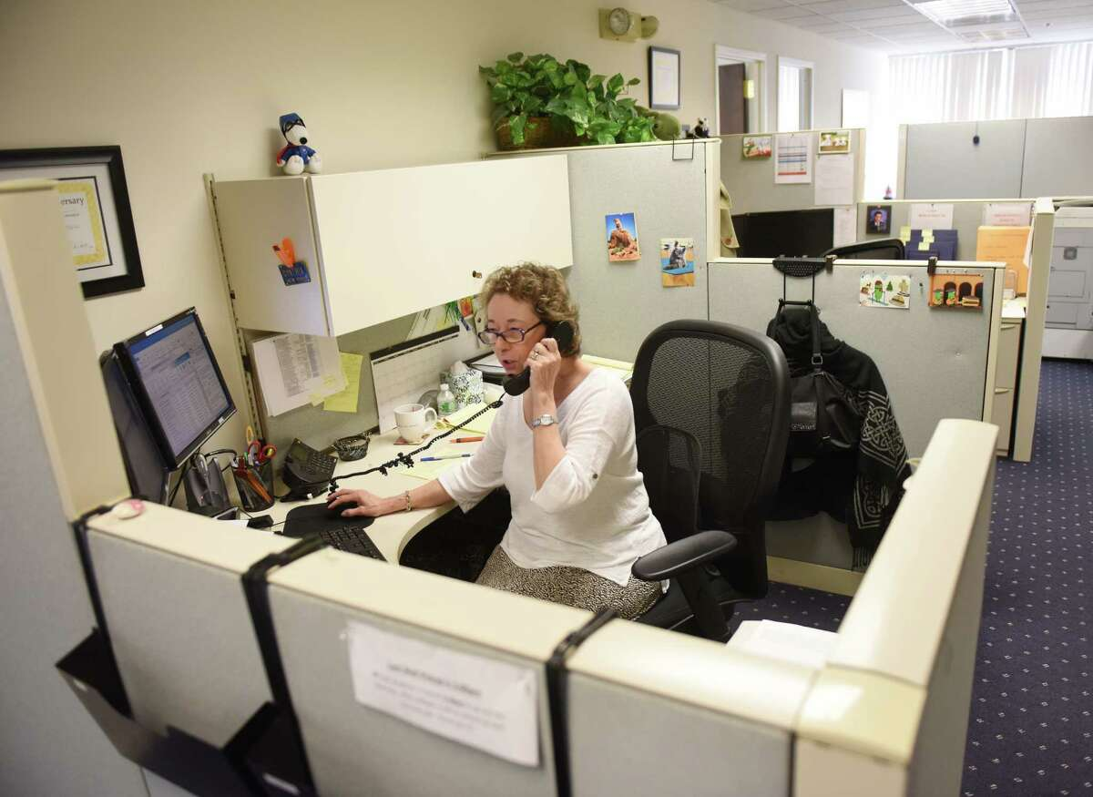 Client Service Representative Cynthia Knight talks on the phone at the CBP office in Stamford, Conn. Monday, July 13, 2015. The privately-owned mid-size consulting firm was named one of the area's best workplaces.