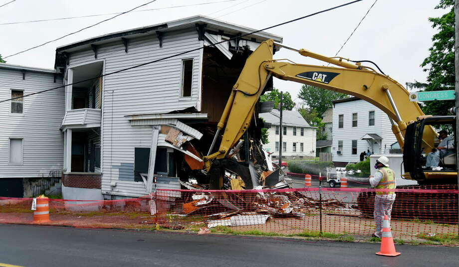 As part of a continuing program, 701 Congress Street is demolished on June 23, 2015, in Schenectady, N.Y.    (Skip Dickstein/Times Union archive) Photo: SKIP DICKSTEIN / 00032369A