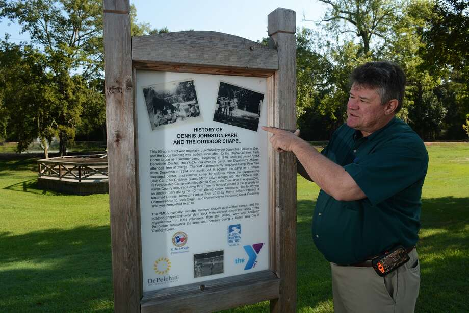 Dennis Johnston, the park director at the Harris County Precinct 4 park in Spring named after him, shows off the sign describing the history of the park on August 27, 2015. (Photo by Jerry Baker/Freelance) Photo: Jerry Baker, Freelance