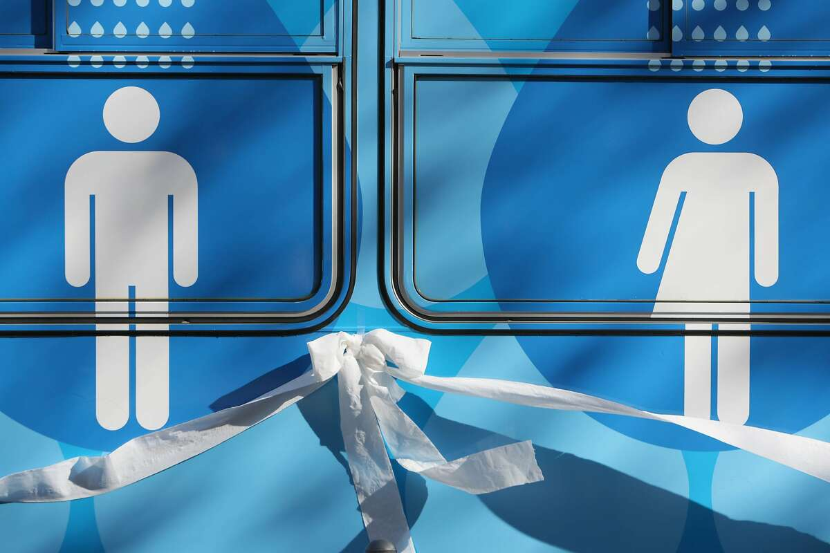 A toilet paper ribbon is seen below graphics on the Lava Mae bus during it's unveiling on Tuesday, September 8, 2015 in San Francisco, Calif.