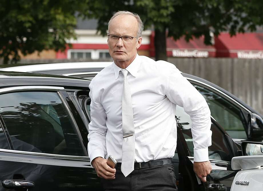 Walter Palmer arrives at his office in Bloomington after weeks out of the public eye. Protesters want an end to trophy hunting. Photo: Jim Mone, Associated Press