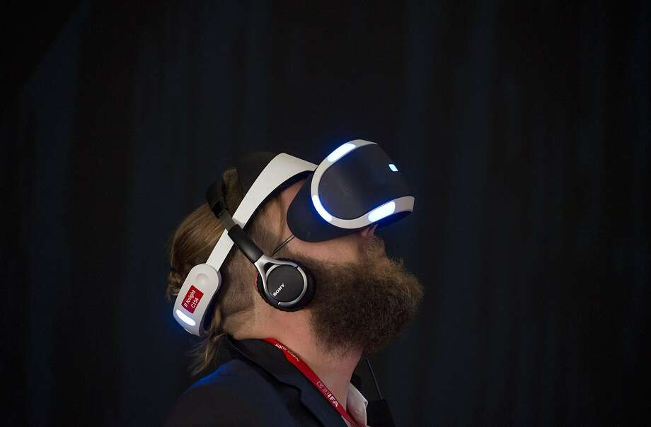 A visitor tries Sony's Project Morpheus virtual reality headset for PlayStation 4 at the booth of Japan's electronics giant Sony ahead of the opening of the 55th IFA (Internationale Funkausstellung), on September 2, 2015 in Berlin. IFA, one of the world's biggest consumer electronics shows, opens for the media before the public is invited from September 4 to 9.  AFP PHOTO / JOHN MACDOUGALLJOHN MACDOUGALL/AFP/Getty Images Photo: John Macdougall, AFP / Getty Images