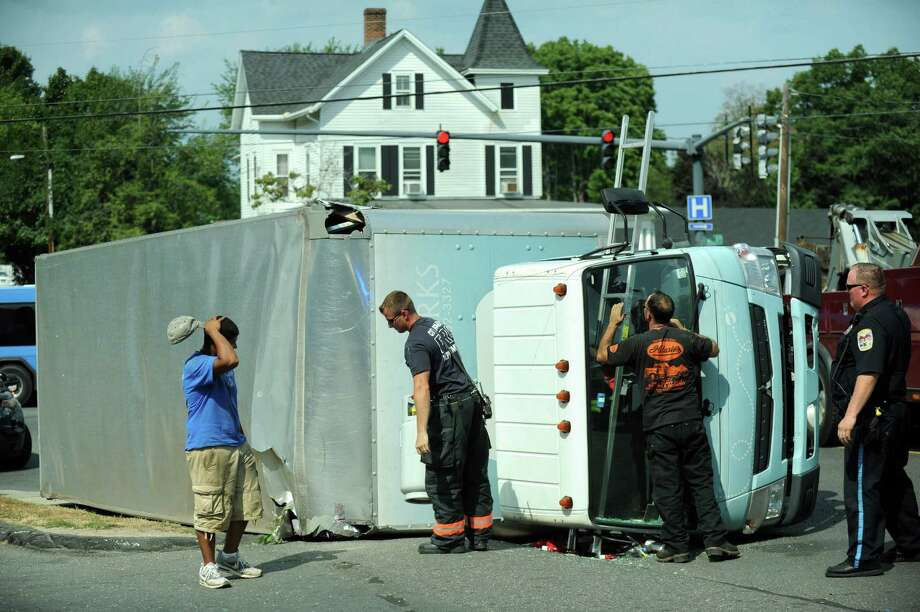 A box truck rolled over in the area of West and Division streets Tuesday afternoon. The accident happened just before 2 p.m. and no one was injured. Photo: Carol Kaliff / Hearst Connecticut Media / The News-Times