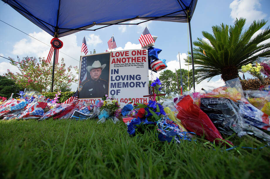 The memorial of Harris County Sheriff's Deputy Darren Goforth is seen at the intersection of West Road and Telge, Tuesday, Sept. 8, 2015, in Houston. The memorial for Deputy Goforth has moved to the grass from pump 8 where it was originally located. Deputy Goforth was fatally shot as he pumped his cruiser with gas Friday, Aug. 28. Photo: Cody Duty, Houston Chronicle / © 2015 Houston Chronicle