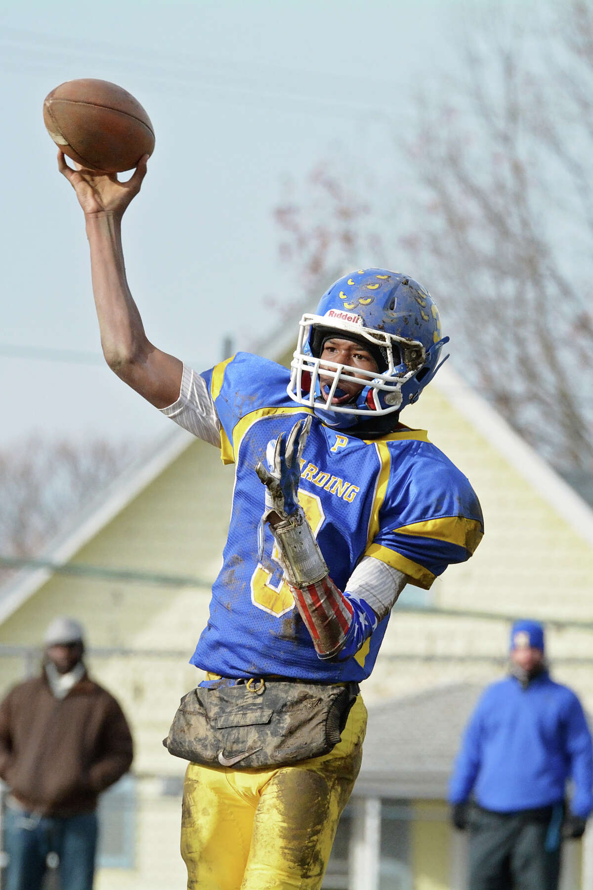 Harding's quarterback Taisun Phommachanh (3) passes the ball during the Thanksgiving day football game against Bridgeport Central High School at Hedges Stadium in Bridgeport on Thursday, Nov. 27, 2014.