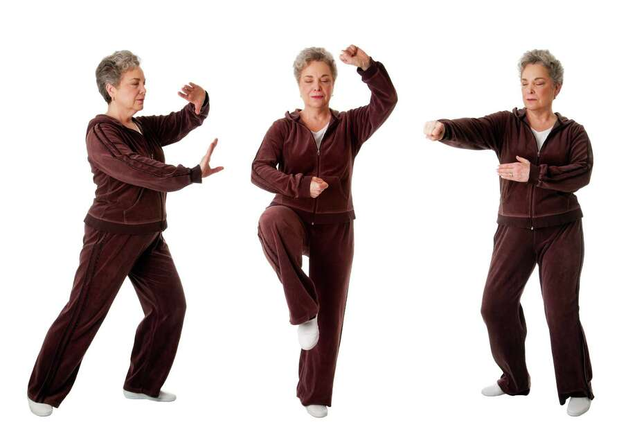 Beautiful Senior woman doing Tai Chi exercise to keep her joints flexible, isolated. Photo: Paul Hakimata - Www.hakimata.com / Paul Hakimata - Fotolia