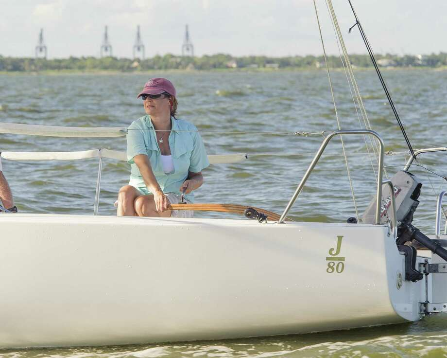 "Karen Penrose, a visually impaired sailor, practices sailing as she prepares for an international competition in Chicago. ""€œI just love being out on the water,""€ she says. Photo: ÂKim Christensen, Photographer / ©Kim Christensen"
