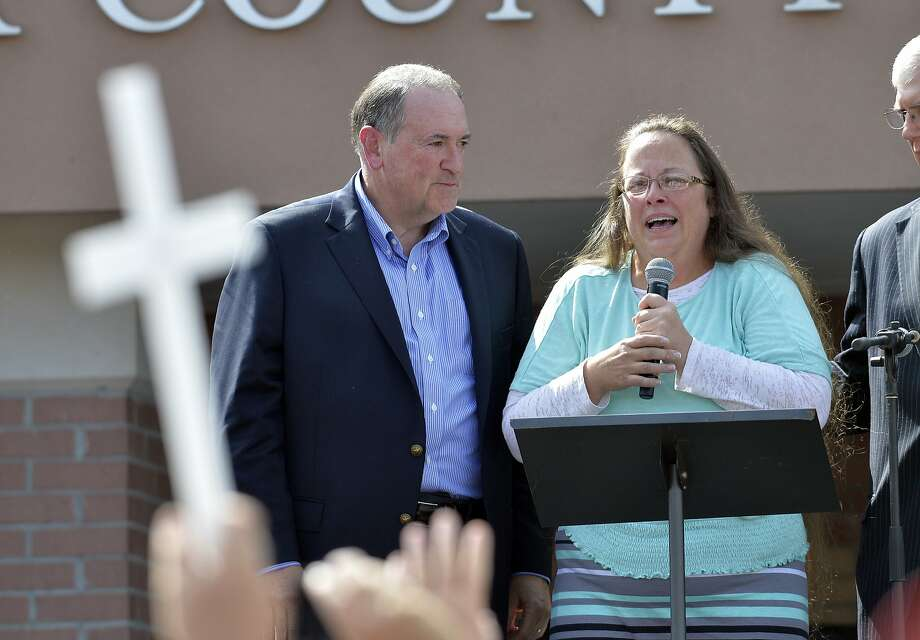 Rowan County Clerk Kim Davis, with Republican presidential candidate Mike Huckabee, left, at her side, speaks after being released from the Carter County Detention Center, Tuesday, Sept. 8, 2015, in Grayson, Ky. Davis, the Kentucky county clerk who was jailed for refusing to issue marriage licenses to gay couples, was released Tuesday after five days behind bars.   (AP Photo/Timothy D. Easley) Photo: Timothy D. Easley, Associated Press