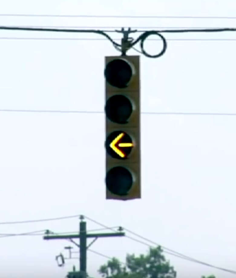 Frame grab from a Michigan Department of Transportation educational video which explains driving rules for blinking yellow directional traffic signals. When the yellow left turn arrow is flashing motorists can turn left if traffic is clear. (Michigan DOT)