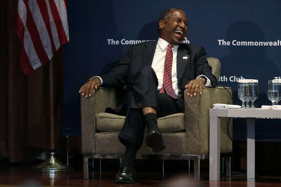 Republican presidential candidate Dr. Ben Carson laughs while talking at the Mark Hopkins Hotel in San Francisco, California, on Tuesday, Sept. 8, 2015.
