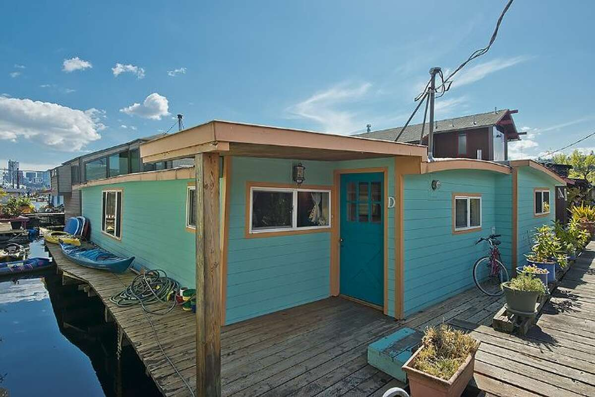 Exterior of 2019 Fairview Ave. E., Slip D. The 85-year-old floating home with two bedrooms and one bathroom is priced at $697,000. The home includes a newly remodeled kitchen and 1,300 square feet.