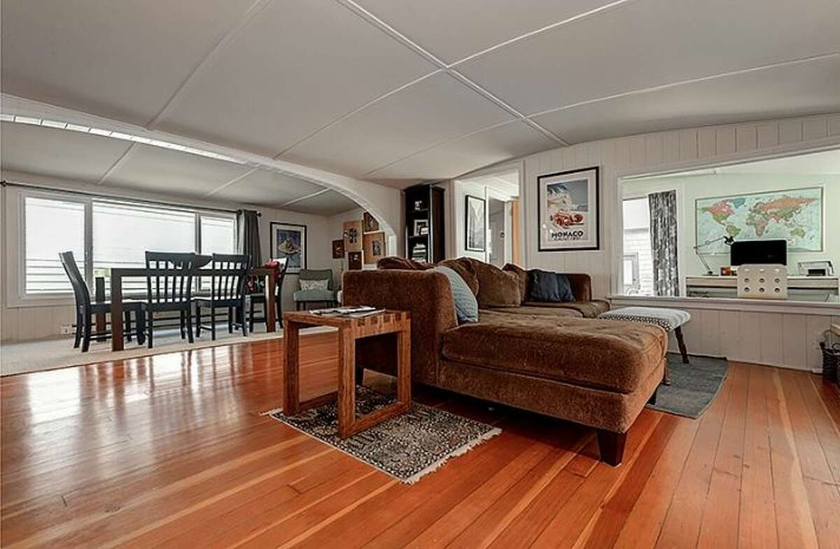 Living, dining areas at 2019 Fairview Ave. E., Slip D. The 85-year-old floating home with two bedrooms and one bathroom is priced at $697,000.