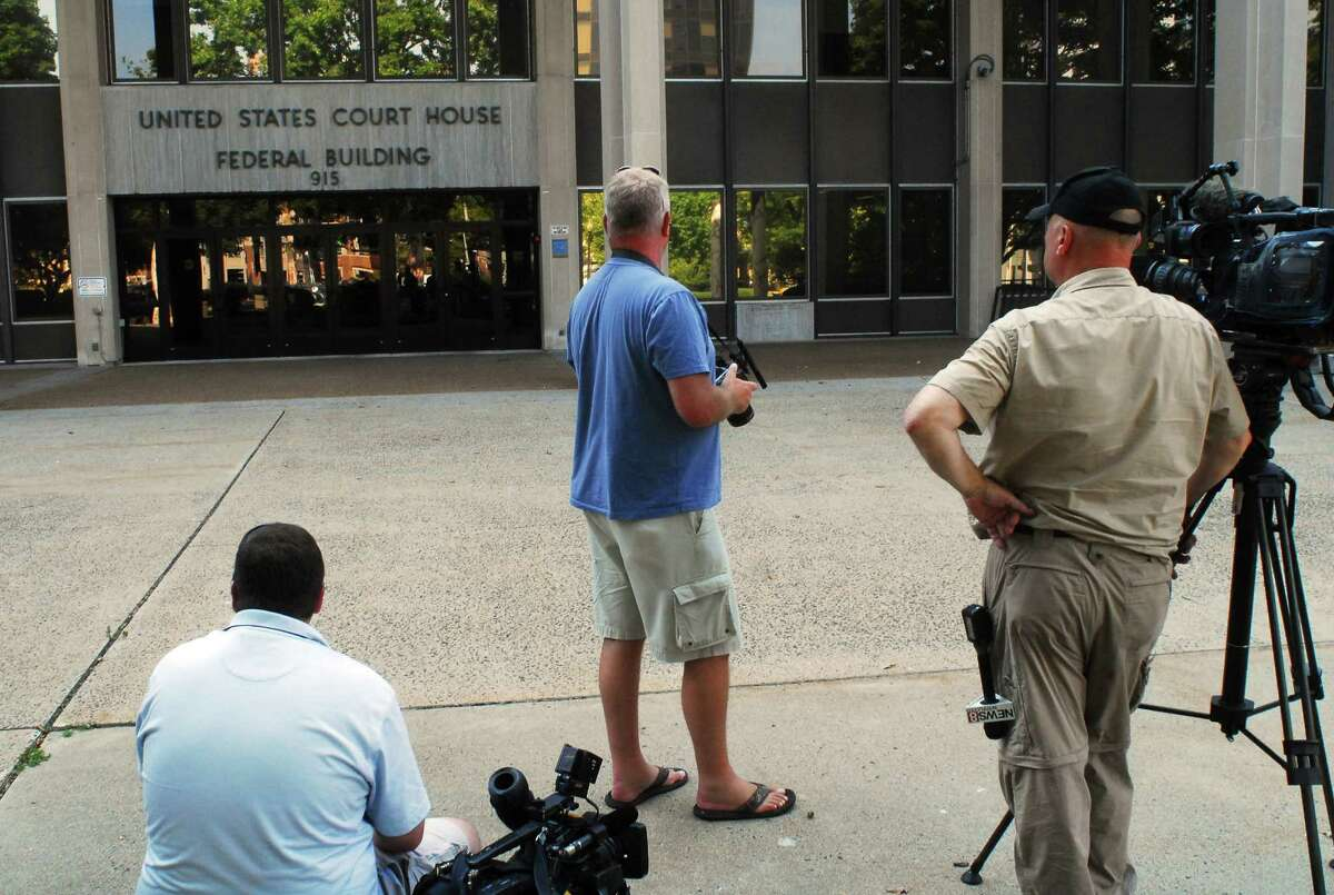 Media gathered outside of US Federal Court on State Street wait for word on Kyle Navin in Bridgeport, Conn., on Tuesday Sept. 8, 2015. Navin has been arrested on federal weapons charges. Kyle's parents Jeffrey and Jeanette Navin have been missing since Aug. 4th.