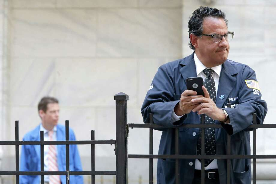 Traders take a break Tuesday outside the New York Stock Exchange. Stocks surged to their second-biggest gain of the year. Photo: Mary Altaffer /Associated Press / AP