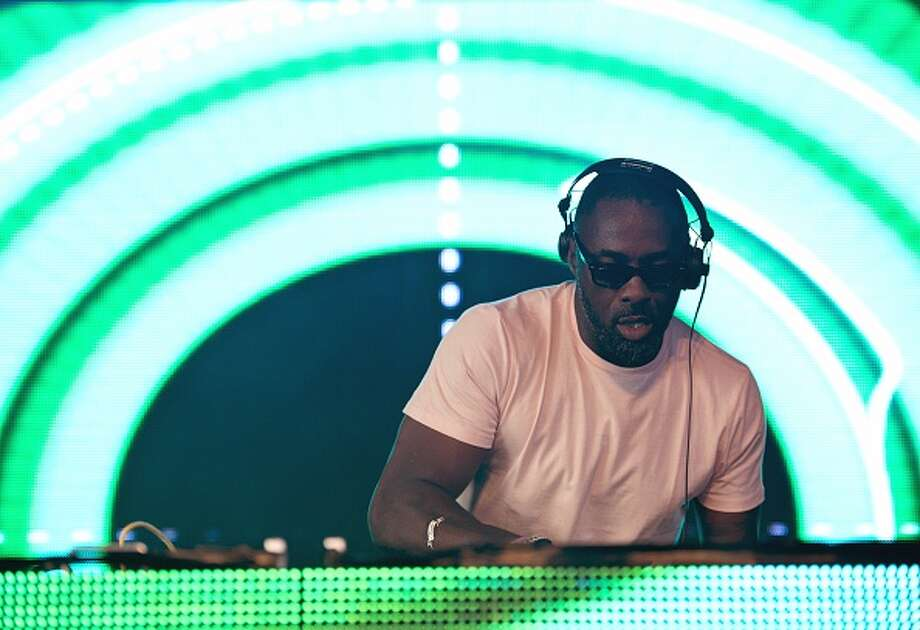 Yep, Stringer Bell is a DJ. Actor Idris Elba goes by the name DJ Big Driis (or Big Driis the Londoner) at his gigs. Here he DJs at Glastonbury Festival of Music and Performing Arts in 2015. Photo: OLI SCARFF, AFP/Getty Images