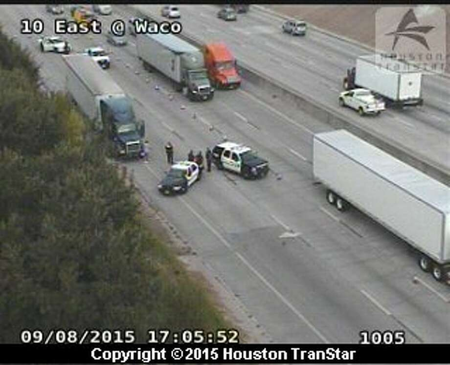 An accident involving an 18-wheeler blocked several lanes of traffic on I-10 East at Waco near downtown Houston, Tuesday, Sept. 8, 2015. Photo: Houston Transtar