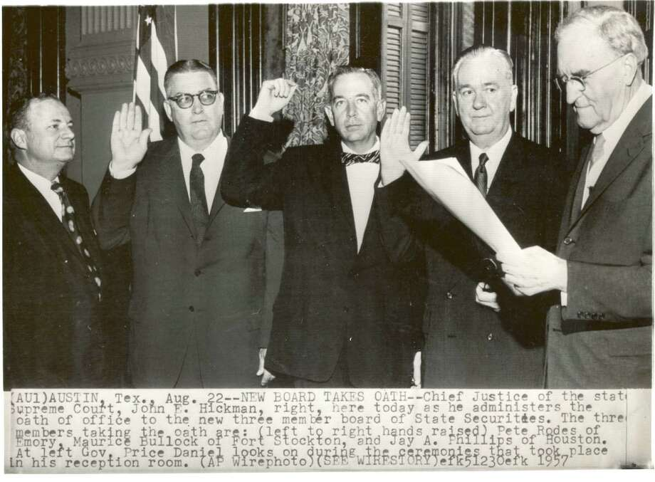 State Supreme Court Chief Justice John Hickman, right, swears in new members to the Texas State Securities Board in 1957. / AP Wirephoto