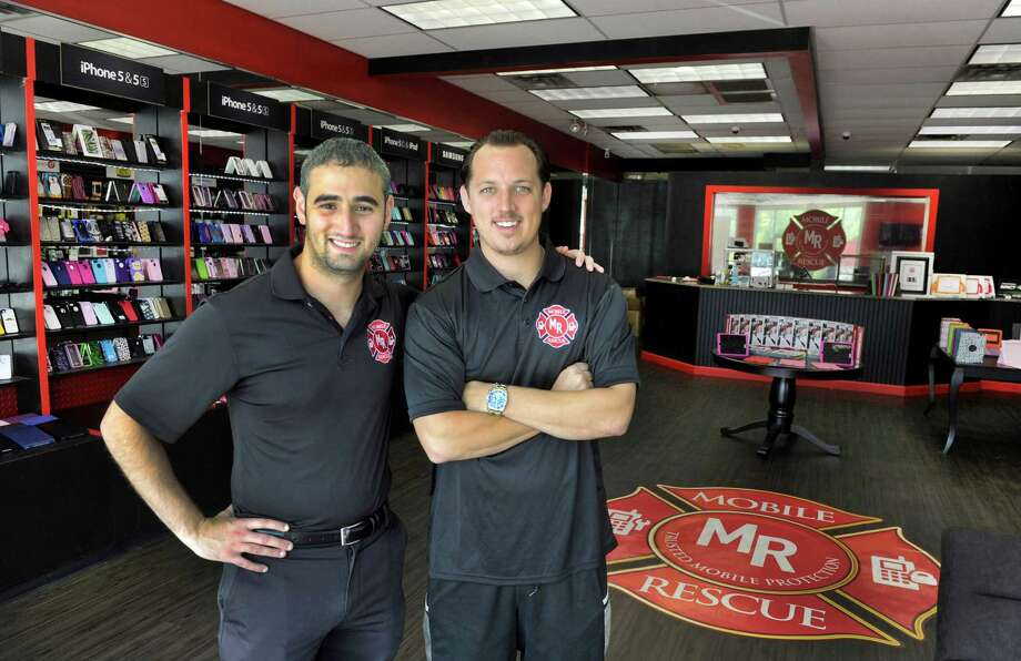 """Matt Abrantes, left, and Eric Walsh, both 27 and residents of Danbury, are co-founders of """" Mobile Rescue."""" Photo Tuesday, Sept. 8, 2015. Photo: Carol Kaliff / Hearst Connecticut Media / The News-Times"""