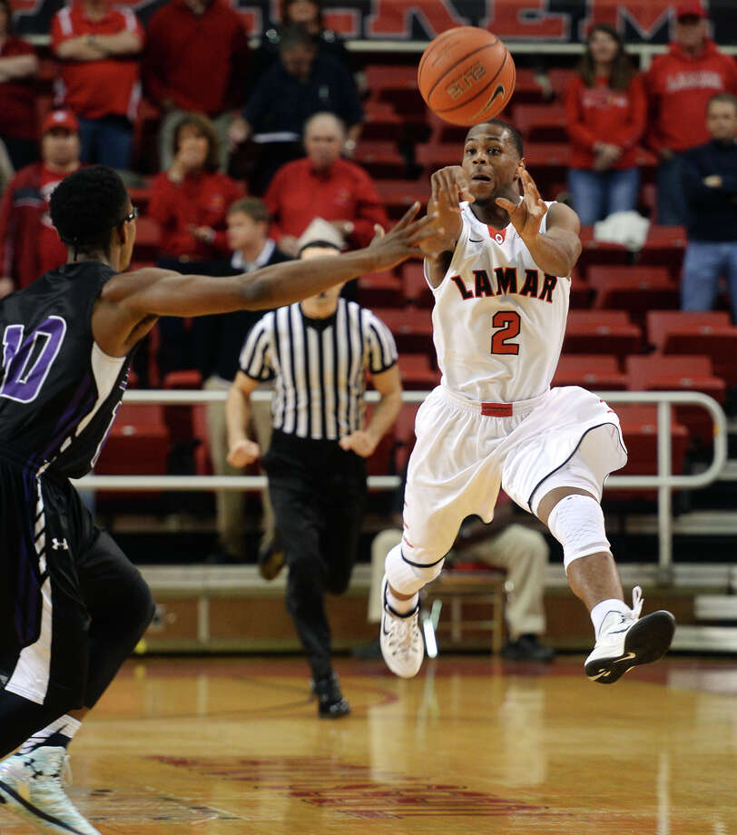 Lamar's Kevin Booze, No. 2, passes to an open teammate during Monday's game against Stephen F. Austin. The Lamar Cardinals hosted the Stephen F. Austin Lumberjacks at the Montagne Center on Monday night. Photo taken Monday 1/26/15 Jake Daniels/The Enterprise   Manditory Credit, No Sales, Mags Out, TV OUT, Web: AP Members Only Photo: Jake Daniels / ©2014 The Beaumont Enterprise/Jake Daniels