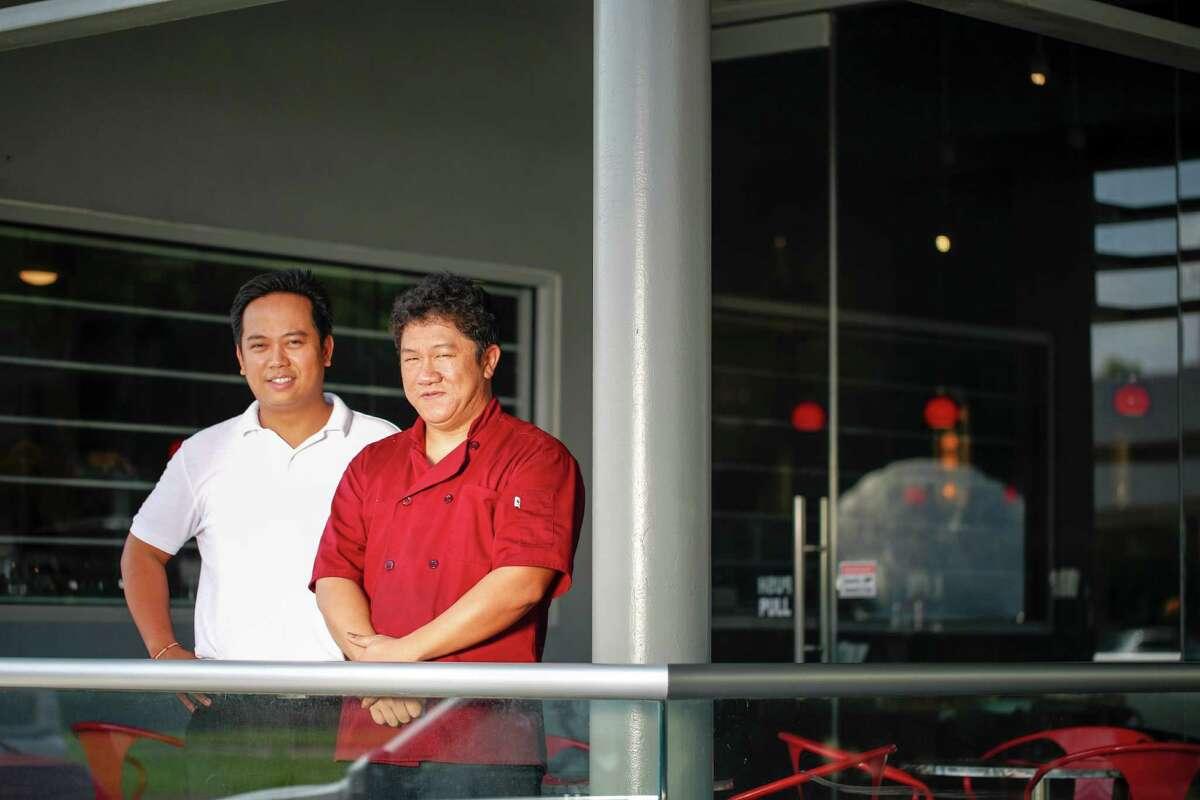 Duc Dunh, left, and his chef Vu Tuan, Saigon House, Tuesday Sept. 8, 2015 in Houston.