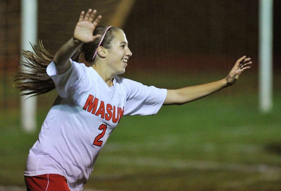 Masuk's Abbey Saia celebrates her goal in the SWC high school girls soccer game between Masuk and Brookfield at Masuk High School in Monroe, Conn. on Thursday, Oct. 10, 2013.  The game ended in a 1-1 tie. Photo: Tyler Sizemore / Tyler Sizemore / The News-Times