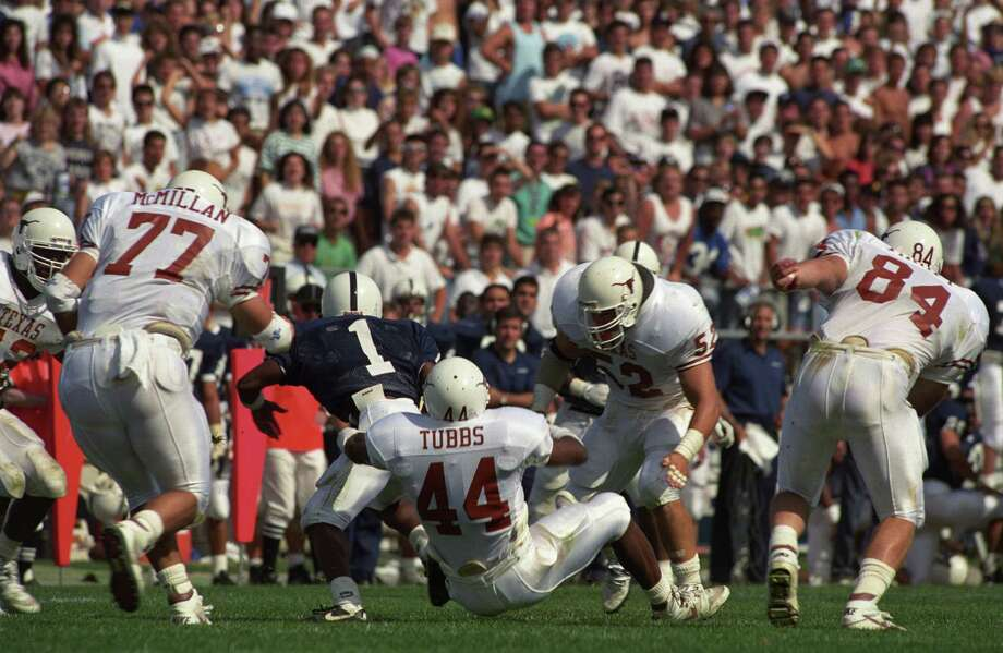 Texas linebacker Winfred Tubbs (44) helps corral Penn State's Leroy Thompson (1) during the Longhorns' 1990 victory at Happy Valley. Photo: Courtesy University Of Texas