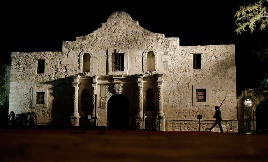 A member of the San Antonio Living History Association patrols the Alamo in San Antonio during a pre-dawn memorial ceremony to remember the 1836 Battle of the Alamo and those who fell on both sides.  (AP Photo/Eric Gay, File) Photo: Eric Gay, STF / AP