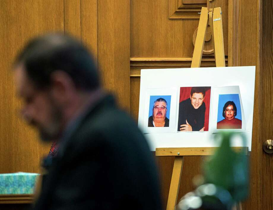 Frazier Glenn Miller Jr.  sits near pictures of his victims during closing arguments in the penalty phase of his murder trial Tuesday in Olathe, Kan.  Photo: Allison Long, POOL / Pool The Kansas City Star