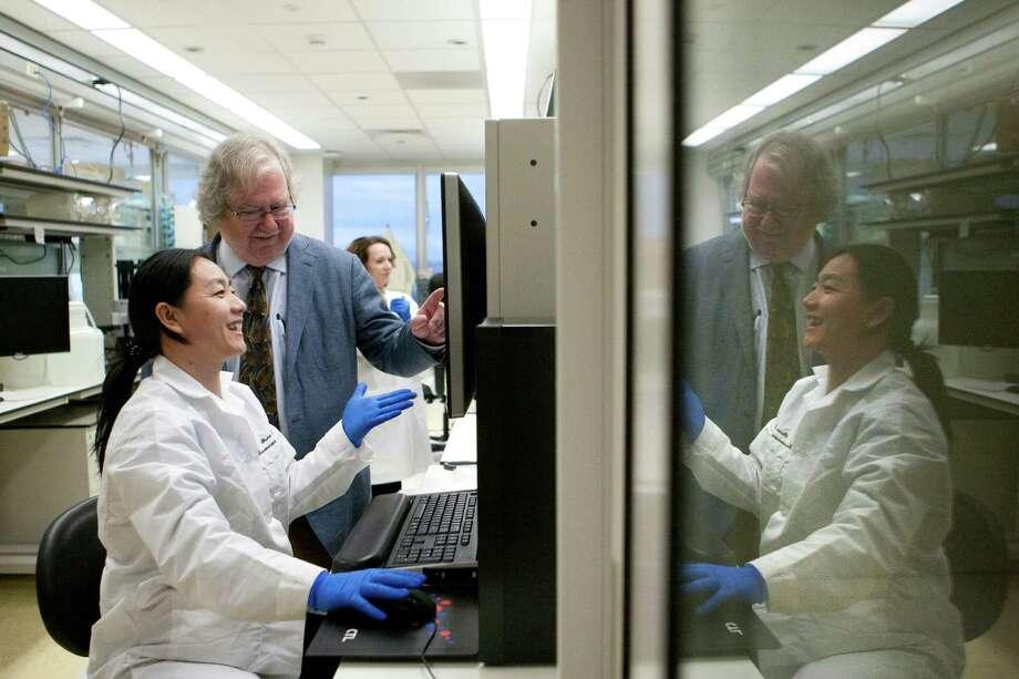 James Allison and senior research assistant Shumin Li analyze lymph cells at M.D. Anderson. Photo: Marie D. De Jeséºs, Staff / © 2013 Houston Chronicle
