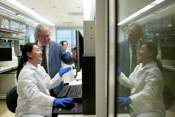 James Allison and senior research assistant Shumin Li analyze lymph cells at M.D. Anderson.