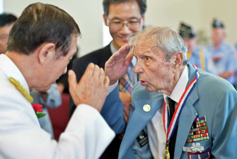 Retired Korean Army Major General Seung Woo Choi, left, salutes US Army Veteran John S. Edwards of Niskayuna  during a ceremony honoring Korean War Veterans at the Korean United Methodist Church Tuesday Sept. 8, 2015 in Clifton Park, NY.  A career soldier Col. Edwards is a veteran of WWII, Korea and Vietnam.  (John Carl D'Annibale / Times Union) Photo: John Carl D'Annibale / 00033112A