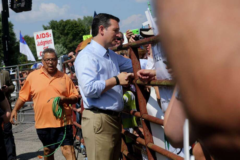 Sen. Ted Cruz (R-Texas), a Republican presidential hopeful, shakes hands with demonstrators outside the Carter County Detention Center prior to the release of Rowan County Clerk Kim Davis in Grayson, Ky., Sept. 8, 2015. Davis, who was held in contempt for defying a court order to issue the licenses to same-sex couples, was ordered freed and released Tuesday. (Andrew Spear/The New York Times) Photo: ANDREW SPEAR, STR / New York Times / NYTNS