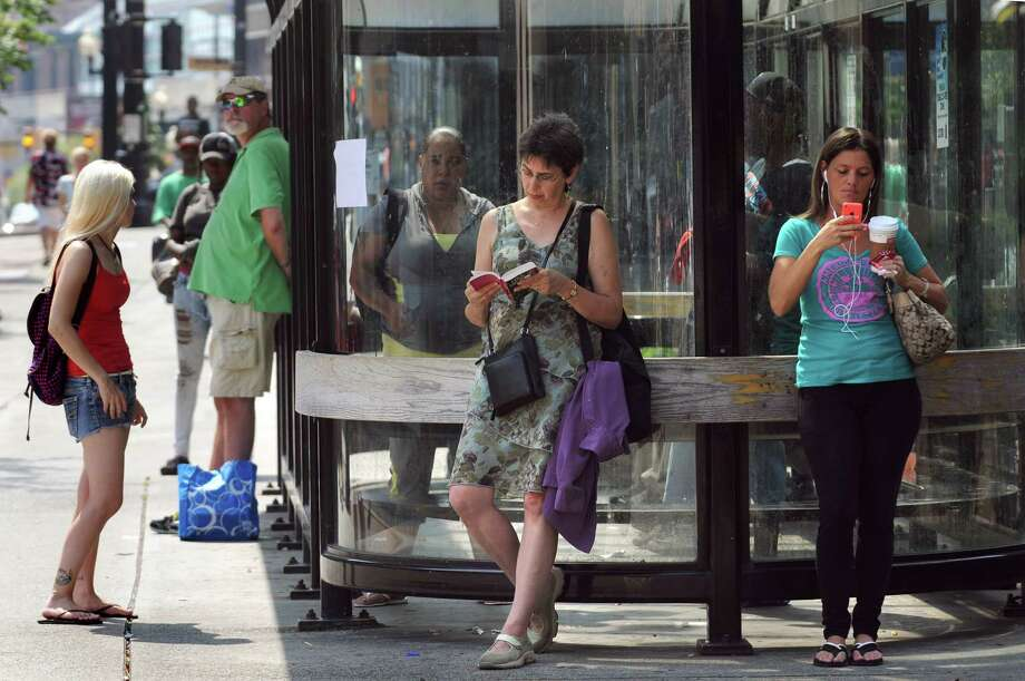 Commuters take shelter in the shade as they wait for the bus on Pearl Street on Tuesday, Sept. 8, 2015, in Albany, N.Y. (Cindy Schultz / Times Union) Photo: Cindy Schultz
