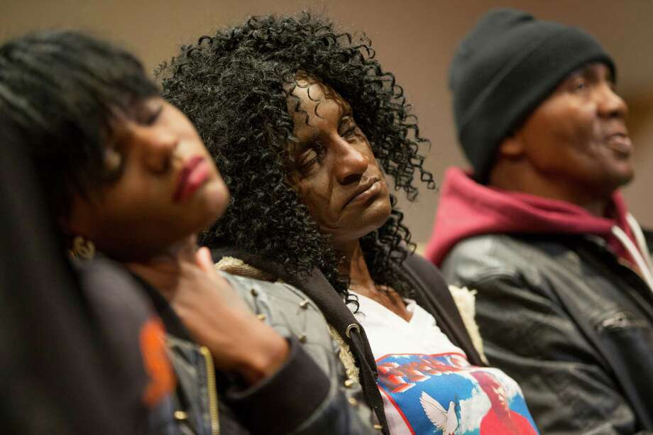 FILE - In this April 27, 2015, file photo, family members of Freddie Gray, sister Fredricka Gray, left, mother Gloria Darden, center, and stepfather Richard Shipley listen during a news conference after a day of unrest following the funeral of Freddie Gray in Baltimore. Gray's parents reached a tentative $6.4 million settlement with the city of Baltimore. The deal, announced Tuesday, Sept. 8, 2015, appeared to be among the largest settlements in police death cases in recent years and happened just days before a judge is set to decide whether to move a trial for six officers charged in Gray's death. (AP Photo/Evan Vucci, File) Photo: Evan Vucci, STF / Associated Press / AP