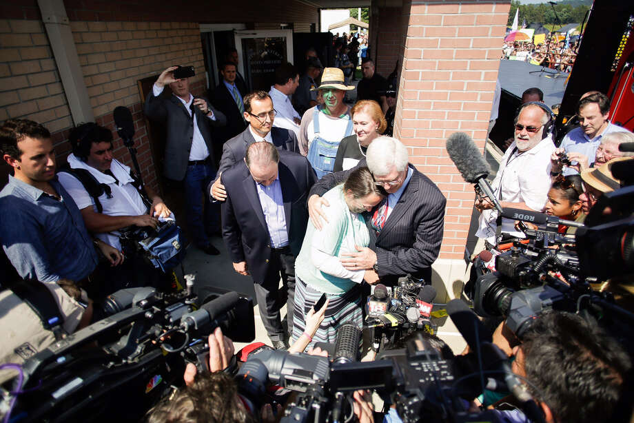 Rowan County clerk Kim Davis, center, hugs her attorney, Matt Staver, with Republican presidential candidate Mike Huckabee, center left, after being released from jail on Tuesday in Grayson, Ky.  Photo: Jonathan Palmer, MBO / The Courier-Journal