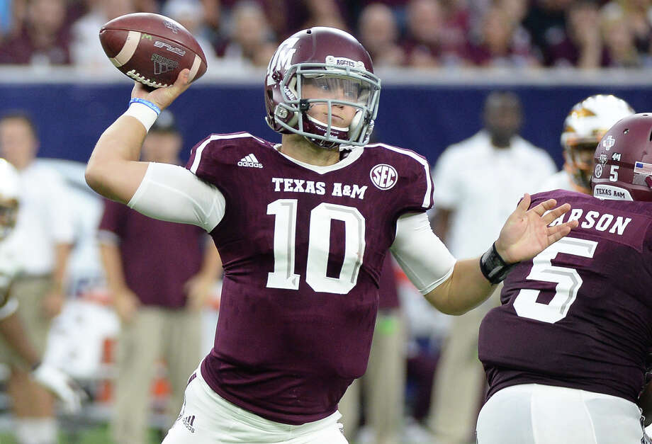 Texas A&M quarterback Kyle Allen (10) passes against Arizona State on Sept. 5, 2015, in Houston. Photo: George Bridges /Associated Press / FR171217 AP