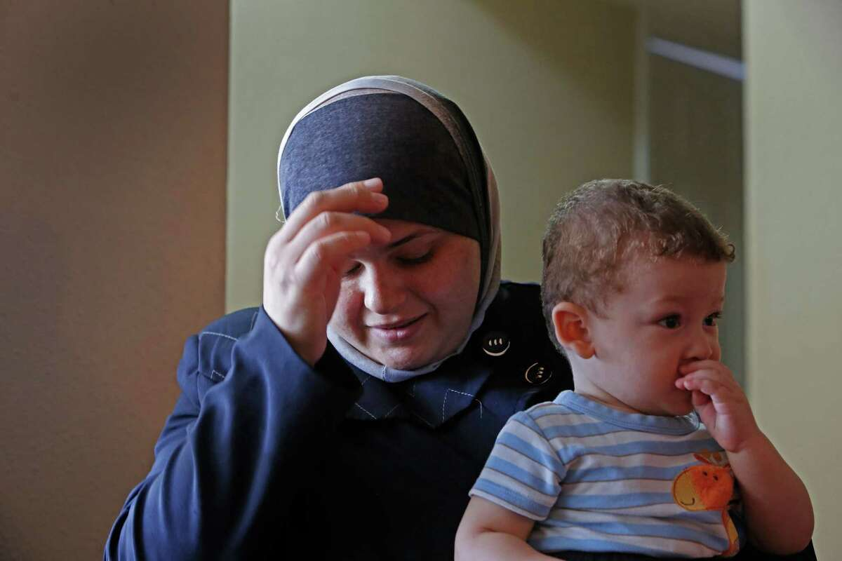 Manal Halabeya holds her son Sultan.