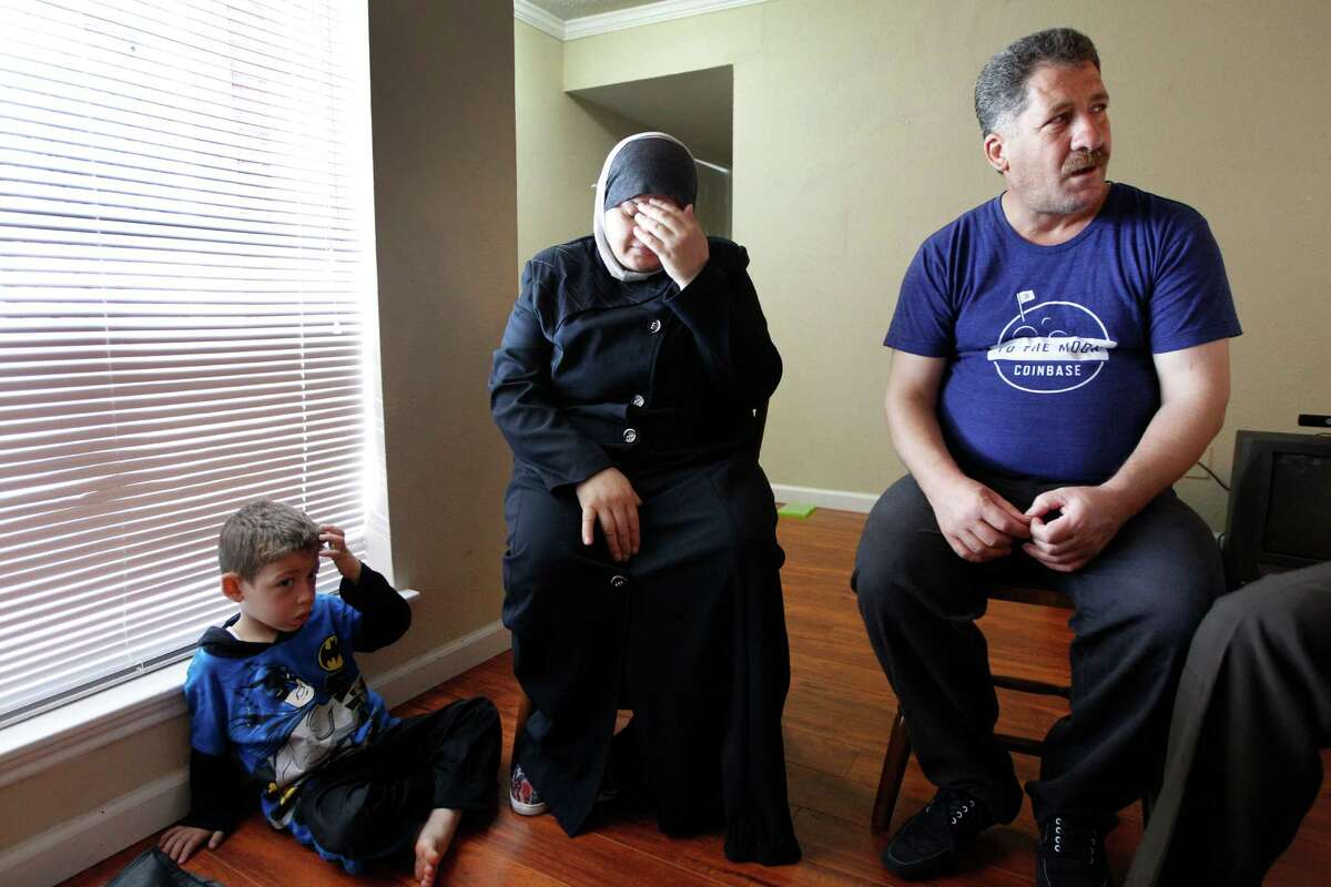 Emad Halabeya, his wife, Manal, and their son Noor in their apartment Tuesday.