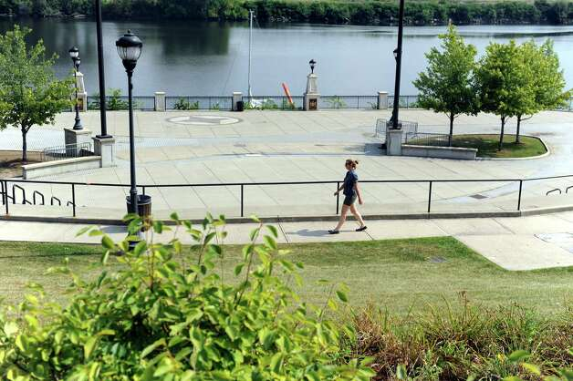 A pedestrian walks by the amphitheater on Tuesday, Sept. 8, 2015, at the Corning Preserve in Albany, N.Y. Sen. Chuck Schumer is proposing funding to enhance city recreation areas like the Corning Preserve. (Cindy Schultz / Times Union) Photo: Cindy Schultz / 00033260A