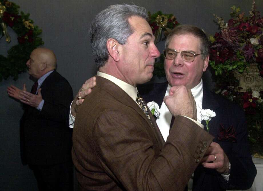 Bobby Valentine, Mets Manager and Stamford native, clowns around with former Rippowman football coach Allen Shanen before the Stamford old Timer's Athletic Association 58th Annual Dinner. Photo: Paul Desmarais / ST